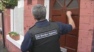 UK Border Agency officials knocking on the Vahidis' door