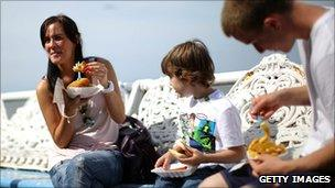 Family eating fish and chips in Blackpool
