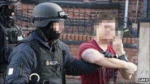 Arrest during armed raid in Wigan