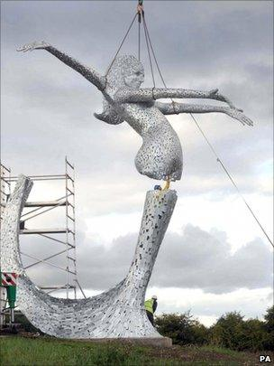 Sculpture being lifted into place