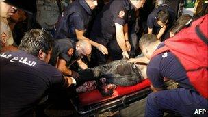 An injured man is treated by paramedics in Beirut (24 August 2010)