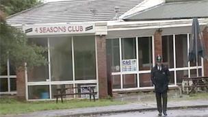 A policeman on duty outside the former social club