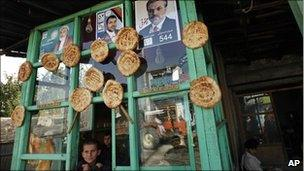 Election posters on a bakery near Kabul on 23 August, 2010
