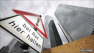 """Road sign saying """"stop here on red light"""" outside Deutsche Bank's headquarters in Frankfurt"""