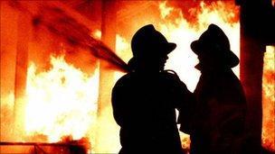 Firemen fighting fire
