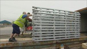 Workers loading bridges