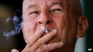 A man smokes a cigarette in Havana - 25 August 2010