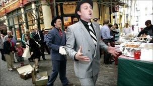 Street performers Jim and Bert entertain the crowds in London