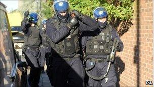 Police prepare to raid a property as part of Operation Razorback