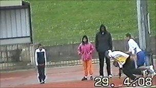 Image shows Matthew Thomas training youngsters at Croydon Athletics Track