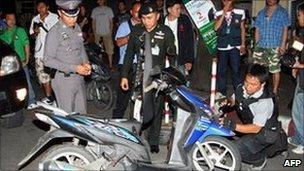 Police check scene of bomb, Bangkok, 28 August 2010