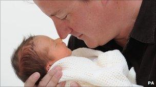 David Cameron holding his baby daughter, Florence Rose Endellion Cameron
