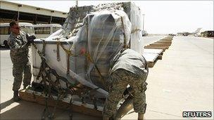 US soldiers pack equipment into an aircraft as they prepare to leave Iraq, 27 August 2010
