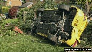 Overturned car in garden (pic: MEN syndication)