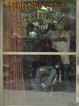 A barber works in a salon in Havana on 7 September 2010