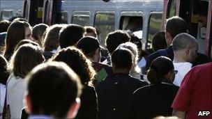 Commuters in London boarding a train