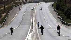 Children play on an empty road during the Jewish holiday of Yom Kippur in Jerusalem.