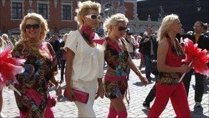 Blonde women march through Riga, Latvia. Photo: May 2010