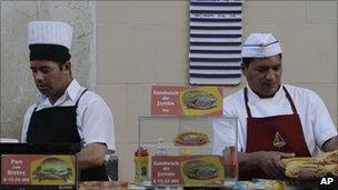 Canteen workers prepare sandwiches in Havana, Cuba