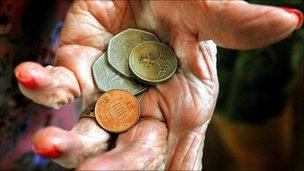 Elderly lady holding coins