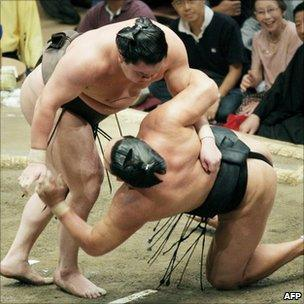 Mongolian grand champion Hakuho (L) at the Autumn Grand Sumo Tournament in Tokyo