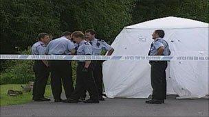 Police at the scene of the murder near Maesteg in 2007
