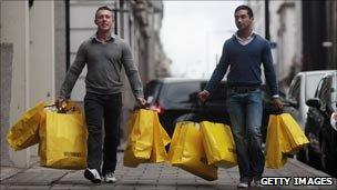 Men loaded with shopping bags
