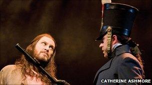 Valjean (David Shannon) and Javert (Earl Carpenter) Photo by Catherine Ashmore
