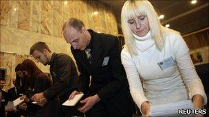 Polling station workers count ballots in Riga - 2 Oct 2010