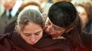 President Mitterand's daughter Mazarine Pingeot-Mitterand is comforted by her mother at his funeral in January 1996