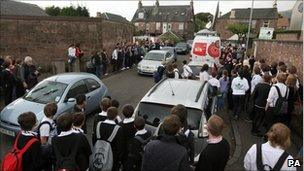 Crowd outside Gamu's house