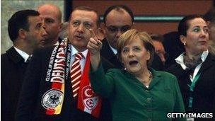 Turkish PM Recep Tayyip Erdogan and German Chancellor Angela Merkel