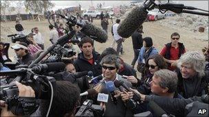 Miner Juan Carlos Aguilar returns to the San Jose amid a media scrum (17 Oct 2010)