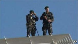 Turkish soldiers on security duty on a rooftop near the courthouse in Diyarbakir
