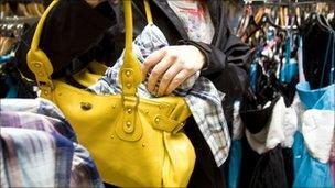 Reconstruction of woman shoplifting
