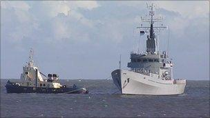 Former HMS Dumbarton Castle being towed