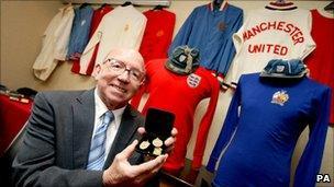 Nobby Stiles with his football memorabilia