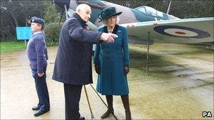 The Duchess of Cornwall talks to William Walker, 97, the oldest survivor of the Battle of Britain in front of a Spitfire