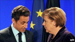 French President Nicolas Sarkozy with German Chancellor Angela Merkel in Deauville, 19 Oct 10