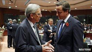 Luxembourg PM Jean-Claude Juncker (left) with UK Prime Minister David Cameron at summit, 28 Oct 10