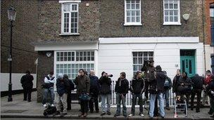 Photographers and camera crews wait for Kate Middleton to leave her Chelsea flat on her 25th birthday on January 9, 2007 in London
