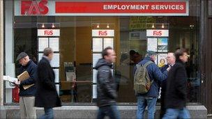 People walk past a recruitment office in Ireland