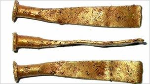 Part of Late Bronze Age gold pennular ribbon bracelet found at Syon Park. Copyright: Museum of London