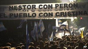 Procession in Buenos Aires the day after Nestor Kirchner's death, with banner reading: Nestor with Peron, the people with Cristina