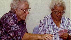 Two pensioners playing cards
