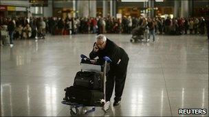 A passenger at Madrid's Barajas airport (Saturday 4 December)