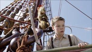 Eustace (Will Poulter) on the Dawn Treader with Reepicheep the swashbuckling mouse (voiced by Simon Pegg)