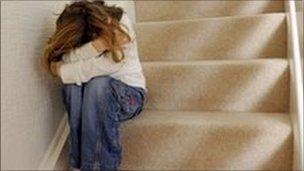 Scared child on stairs