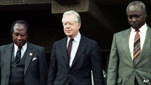 Robert Ouko (left), ex US President Jimmy Carter (c) and President Moi (right)