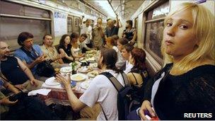 Voina holding a funeral feast on the Russian metro for a dissident poet in 2007